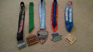 Finisher medals from 5 half marathons in 8 weeks.